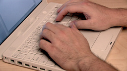 Typing on vintage Laptop Footage