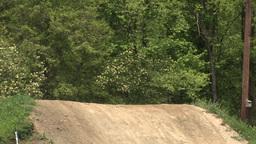 Dirt Bikers Jump Hill Stock Video Footage