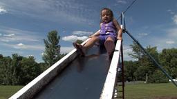 Girl on slide Stock Video Footage