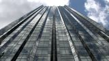 Looking Up From The Foot Of A Modern Steel And Glass Skyscraper stock footage