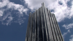 Modern Skyscraper With Moving Clouds And Blue Sky Background Stock Video Footage