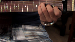 A young man plays the guitar Footage