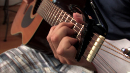 A young man plays the guitar Stock Video Footage
