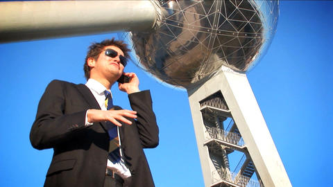 Wide shot of businessman in suit on mobile Stock Video Footage