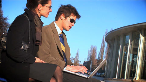 Wide shot of 2 businesspeople on laptop Footage