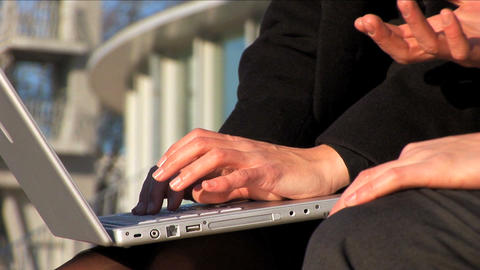 Closew up of business couple on the laptop outside Stock Video Footage