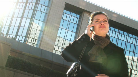 Businesswoman on mobile in city Footage