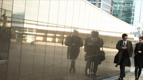 Business couple in city walking to the office Stock Video Footage