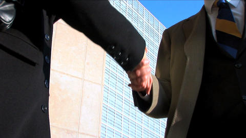 Business couple in city meeting handshake, close up Stock Video Footage