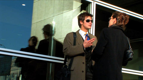 Business couple in city meeting outside office Footage