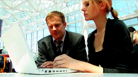 Business couple doing business at their European conference Stock Video Footage