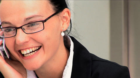 Portrait of a young businesswoman on a mobile phone Stock Video Footage