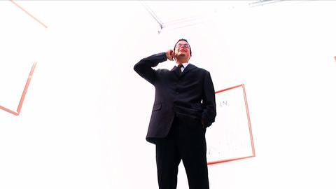 Young businessman using a mobile phone on white background Footage