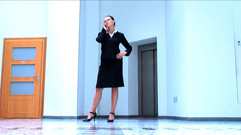 Young business woman in a modern working environment Stock Video Footage