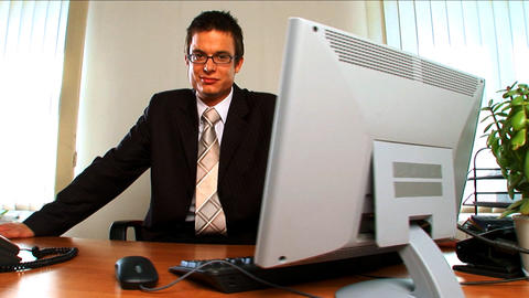 Portrait of a young businessman in a modern working... Stock Video Footage