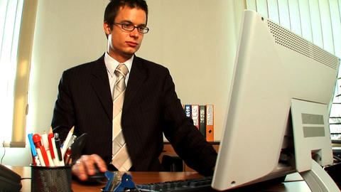 Young businessman in a modern working environment Footage