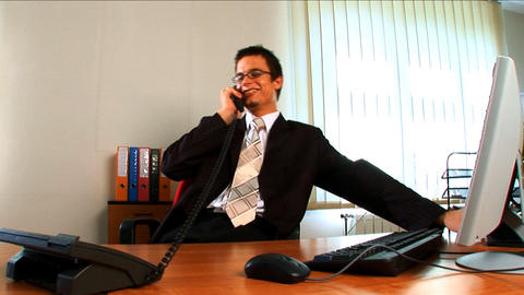 Young businessman in modern working environment Stock Video Footage