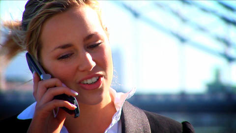 Attractive blonde businesswoman working with technology Live Action