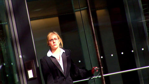 Attractive businesswoman in city leaving the office Stock Video Footage