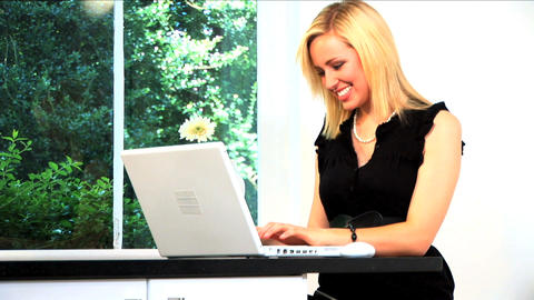 Beautiful blonde businesswoman works from home Stock Video Footage