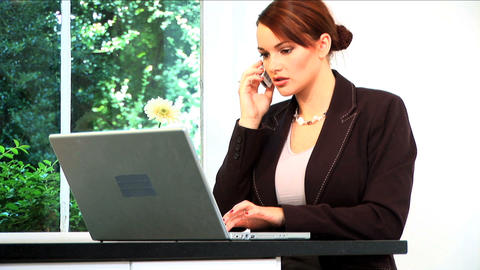 Attractive brunette businesswoman works from home Footage