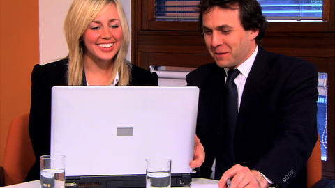 Businesswoman and businessman working on the PC Footage