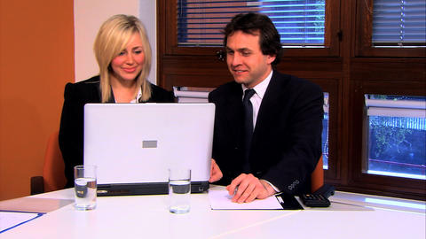 Businesswoman and businessman working on the PC Stock Video Footage