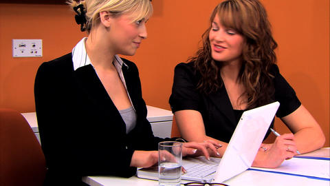 Attractive businesswomen working at the office together Footage