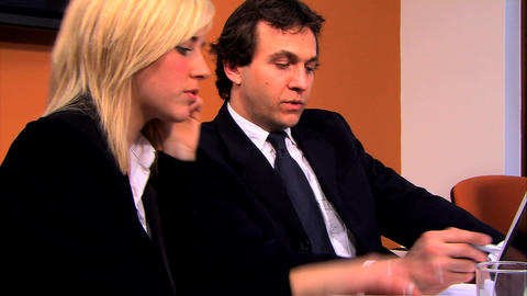 Businesswoman and businessmen using technology in the office environment Footage