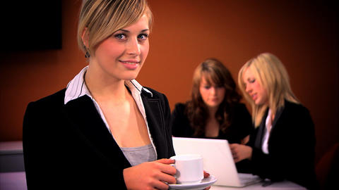 Blonde businesswoman with team in background Stock Video Footage