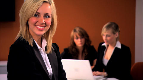 Attractive businesswoman with team in background Stock Video Footage