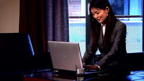 Attractive Japanese businesswoman working in the home office Footage
