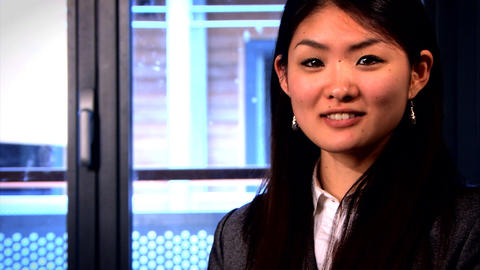 A portrait of an attractive Japanese businesswoman Stock Video Footage