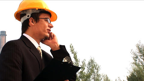 Male environmental officer visits industrial area for... Stock Video Footage