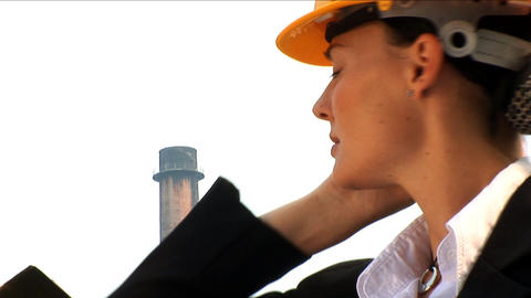 Female environmental officer visits industrial area for... Stock Video Footage