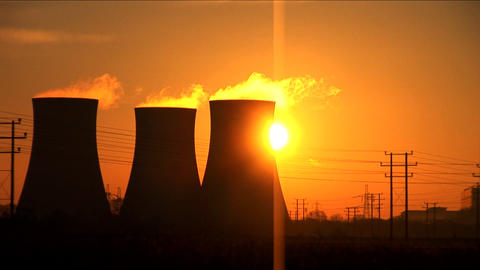 Sun rises above a coal fired power station Footage