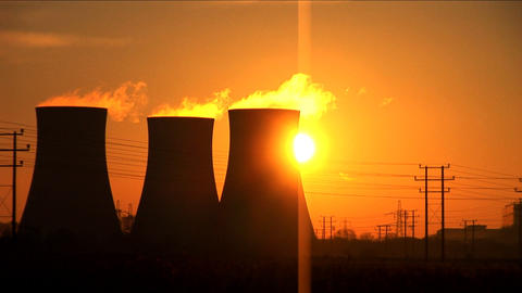 Sun rises above a coal fired power station Stock Video Footage