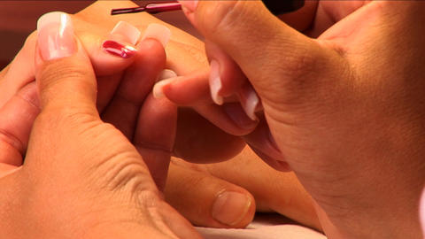 Fingernail manicure & polish being applied at beauty spa in close-up Footage