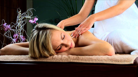 Beautiful blonde girl having massage treatment at a... Stock Video Footage