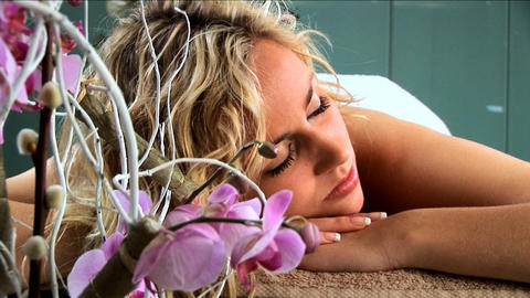 Beautiful blonde girl having hot stones massage treatment... Stock Video Footage