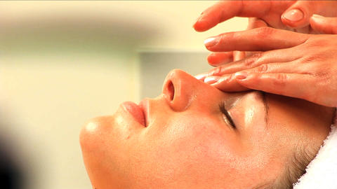 Beautiful blonde girl having facial massage at beauty spa... Stock Video Footage