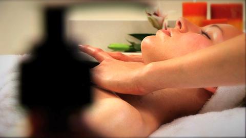 Beautiful blonde girl at health spa having massage... Stock Video Footage