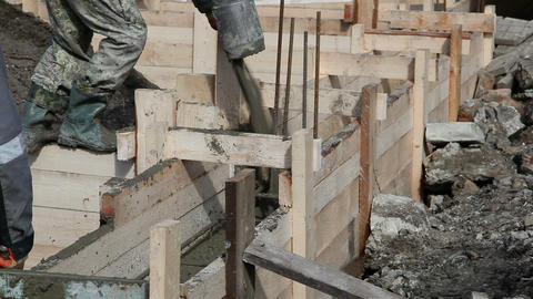Worker pours the foundation of building Stock Video Footage