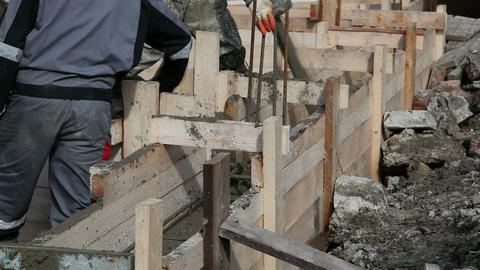 Worker pours the foundation of building Footage