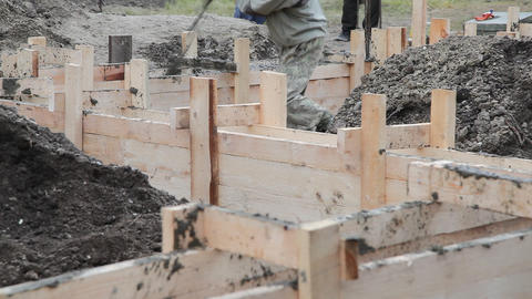 Worker Pours The Foundation Of Building stock footage
