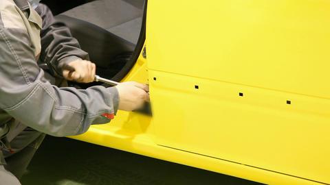 Car's door installation Footage