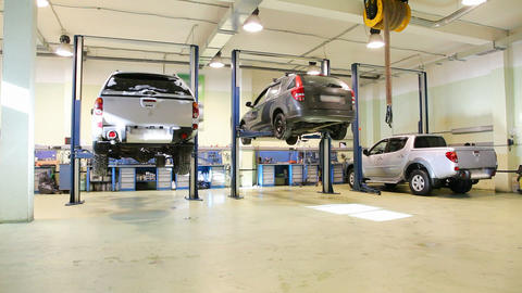 Car repair shop , crane shoot Stock Video Footage