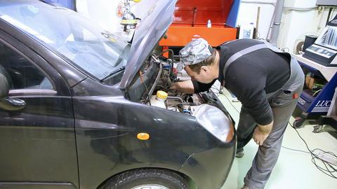 Man repair engine Stock Video Footage