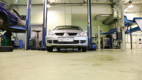 Car repair shop sequence Stock Video Footage