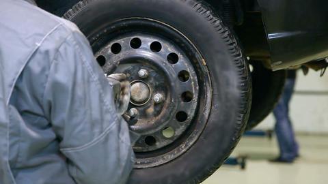 Car wheel installation Stock Video Footage